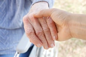 Senior woman's hand and helping hand